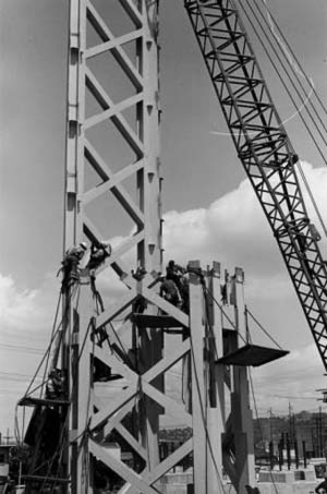 Crane and workers placing section of Space Needle - circa June 1961